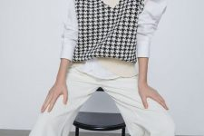 a white shirt with puff sleeves, a creamy printed knit vest, creamy pants for a trendy work look