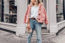 a white sweater, blue cropped jeans, snakeskin print booties, a pink faux fur coat