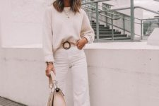 a white sweater, white jeans, snake print booties and a tan bag plus layered necklaces