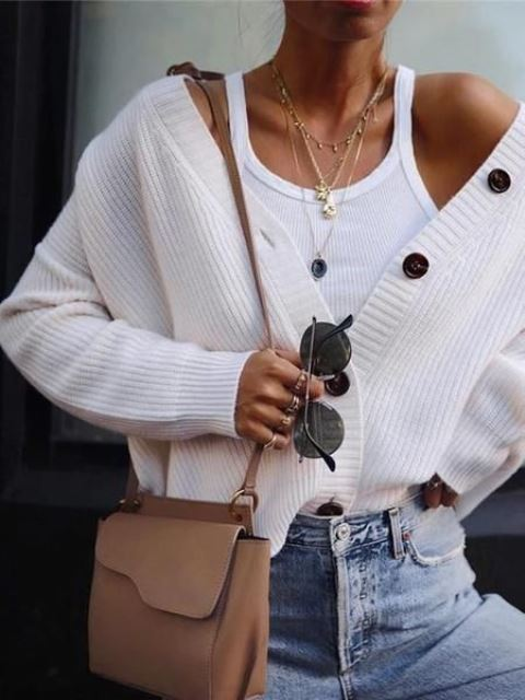 a white tank top, a white oversized cardigan, blue jeans, a camel bag and layered necklaces