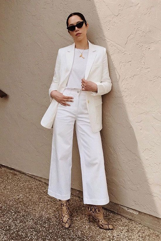a white tee and pants, a creamy blazer, snake print boots and a statement necklace for work