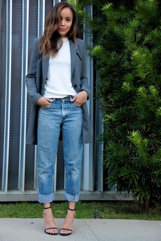 a white tee, blue straight leg jeans, black heeled sandals and a long grey blazer for a casual work look