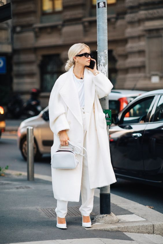 a white tee, high waisted pants, shoes, a wam coat and a small bag for this fall