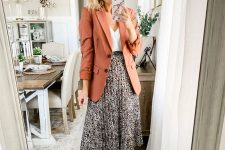 a white top, a printed pleated midi, a rust-colored blazer and tan suede shoes for the fall