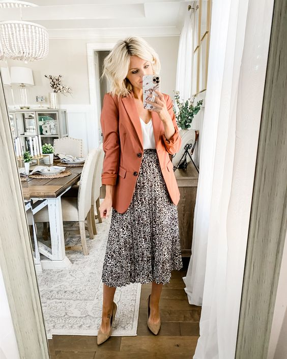 a white top, a printed pleated midi, a rust colored blazer and tan suede shoes for the fall