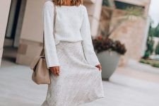 a white top, a white tweed midi skirt, a tan bag and tan booties for a romantic fall look