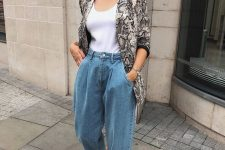 a white top, blue jeans, a snake print blazer and snakeskin shoes for a trendy and chic look