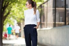 a white turtleneck, navy high waisted pants, white Chelsea boots for a contrasting look