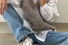 a whte shirt, a grey knit vest, blue jeans and white sneakers for a relaxed fall or winter look