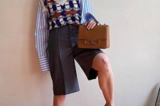 a work look with a blue striped shirt, a printed knit vest, grey Bermuda shorts, a brown bag and matching shoes