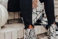 an oversized cashmere sweater, black skinnies, snake print pointed toe boots and a clutch