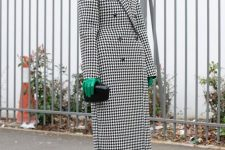 an oversized coat, a black clutch and bright accents – green gloves and bright blue ankle boots
