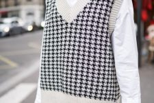 an oversized white shirt, a printed oversized knit vest, black leather shorts, tights for the fall