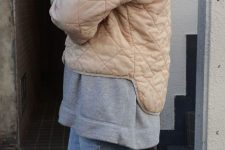blue denim, an oversized grey hoodie and a tan quilted cropped jacket for fall