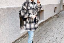 blue jeans, black combat boots, a plaid shirt jacket and a black bag for a comfy everyday look
