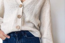 blue jeans paired with a creamy knit cardigan is a simple fall to winter look to try