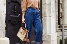 blue slouchy jeans, a tan cardigan tucked in, tan suede shoes and a neutral bag for a chic fall look
