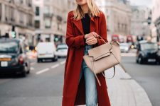 03 a bold casual look with a black tee, light blue jeans, two-tone slingbacks, a tan tote and a burgundy trench