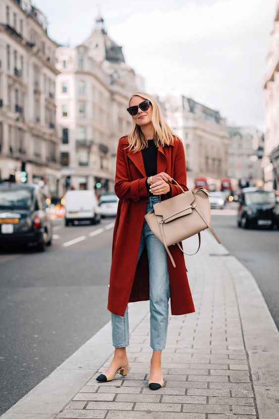 a bold casual look with a black tee, light blue jeans, two-tone slingbacks, a tan tote and a burgundy trench
