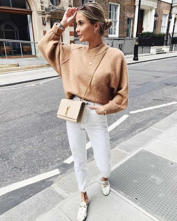 a tan sweater with a high neckline, white jeans, white printed mules and a tan crossbody bag for the fall