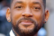 04 Will Smith rocking lobe piercings done with black diamond studs looks stylish and edgy
