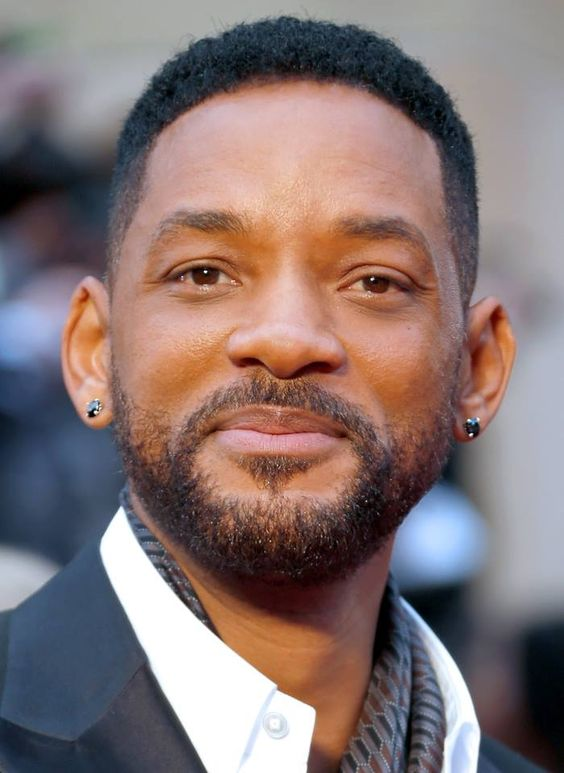Will Smith rocking lobe piercings done with black diamond studs looks stylish and edgy