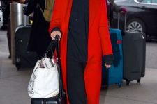 04 a black hoodie, black joggers, white sneakers, a red trench for a bold and chic fall look