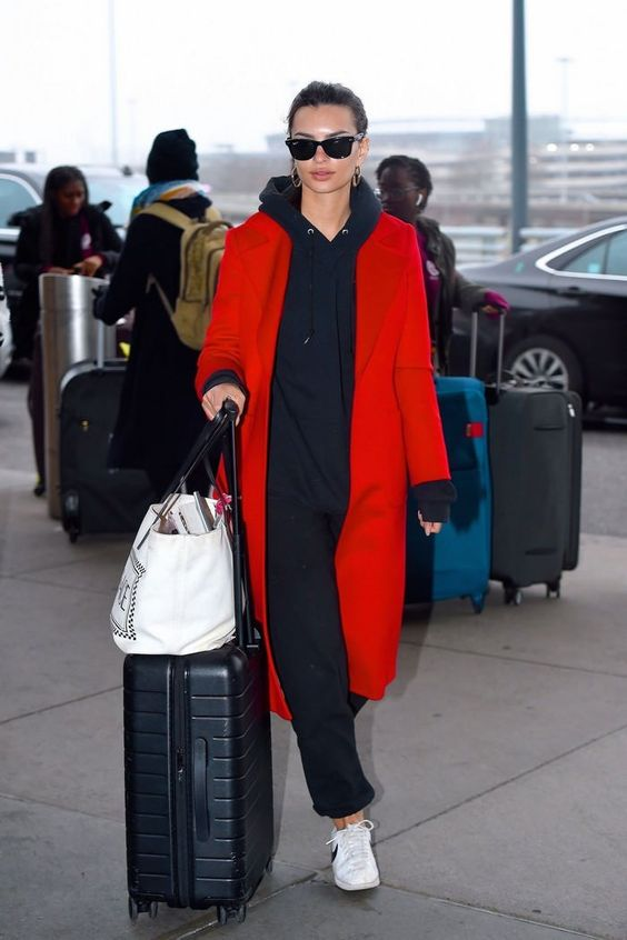 a black hoodie, black joggers, white sneakers, a red trench for a bold and chic fall look