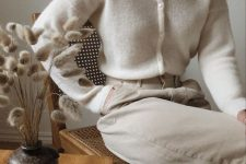 04 a white cardigan tucked into neutral jeans is a very trendy outfit with maximal comfort