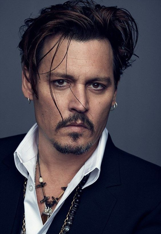 Johnny Depp wearing a double and a single lobe piercing with matching earrings