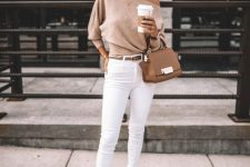 05 a tan one shoulder sweater, white skinnies, white printed mules, a hat and a brown bag