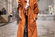 05 a white tee, black leather pants, white booties, an orange trench and a rust bag