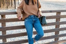 06 a tan ribbed sweater, blue jeans, white mules and a black bag for a stylish fall look