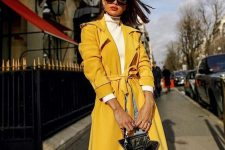 06 a white turtleneck, blue jeans, a sunny yellow trench, a yellow bag for the fall