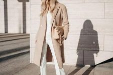 08 a chic neutral outfit with a white top and pants plus booties and a nude coat and a bag
