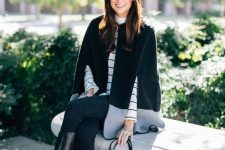 08 a cool preppy outfit with a striped top, a black and grey cape, black skinnies and riding boots
