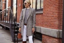 10 a preppy outfit with a grey top, a grey plaid blazer, white skinnies, brown boots and a brown bucket bag