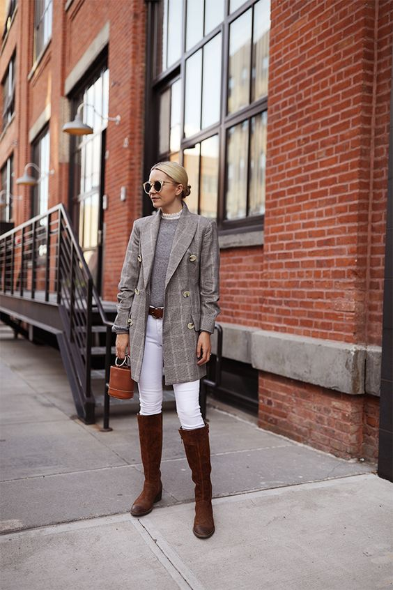 a preppy outfit with a grey top, a grey plaid blazer, white skinnies, brown boots and a brown bucket bag