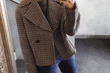 12 a fall look with a grey top, blue jeans, white sneakers, a plaid cropped coat and a brown bag