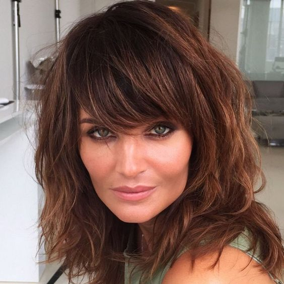messy medium-length chestnut hair with long fringes is a sey and stylish idea to rock