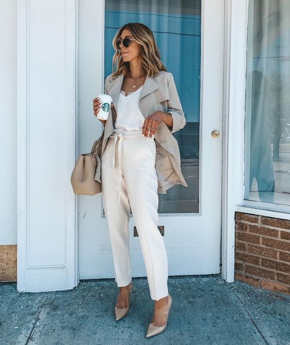 a white lingerie top, creamy pants, nude shoes, an off-white long blazer and a matching bag for work