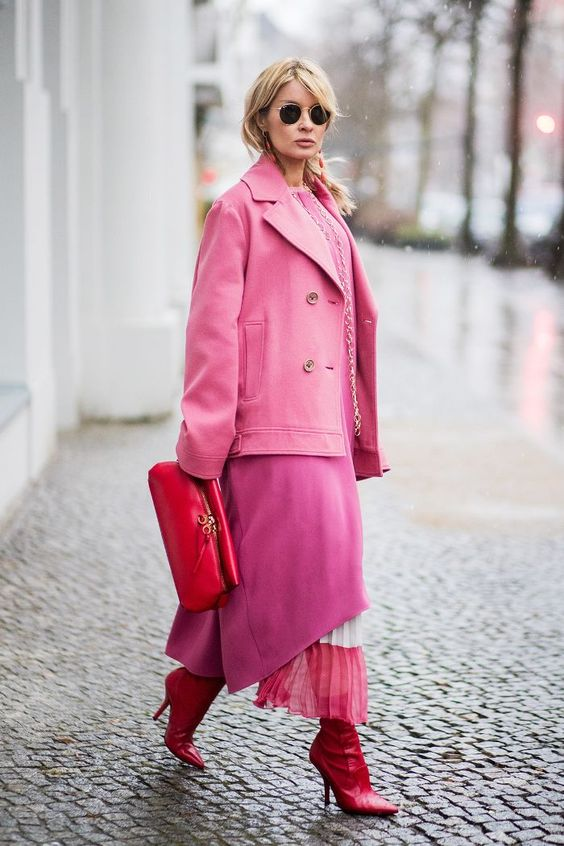 a super bold look with a pink dress, a pink and white skirt, red boots, a hot pink short coat and a red bag