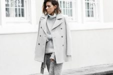 15 a monochromatic look with an oversized sweater, a knit midi skirt, white sneakers, a short coat