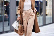 15 a white turtleneck, tan plaid pants, white cutout shoes, a camel coat, a came and white bag