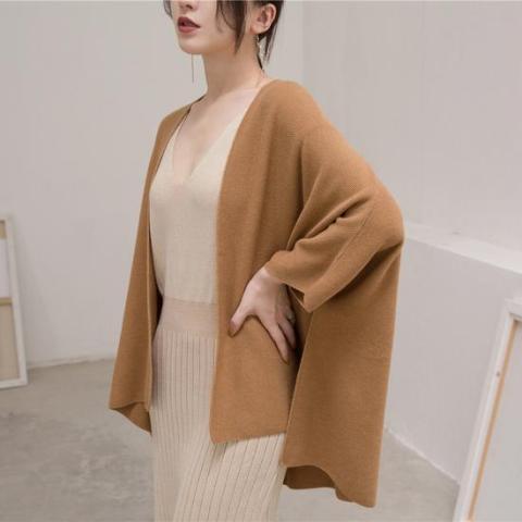With beige V neck dress