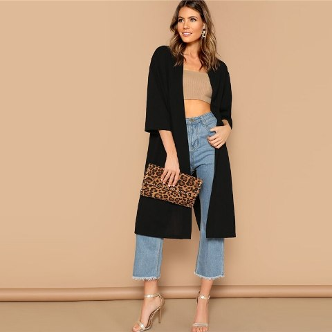 With beige crop top, denim culottes, leopard clutch and ankle strap shoes