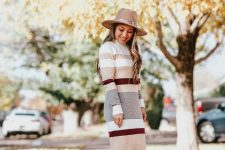 With beige hat and beige suede ankle boots
