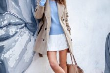 With beige jacket, white pleated skirt, white shoes and tote bag