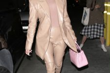 With beige shirt, pale pink leather bag and high heels