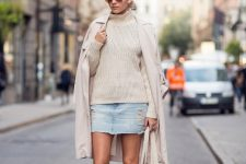 With beige sweater, denim mini skirt, black high boots and tote bag